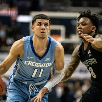Marcus Zegarowski (11) of Creighton is guarded by James Akinjo (3) of Georgetown in the 2nd half.